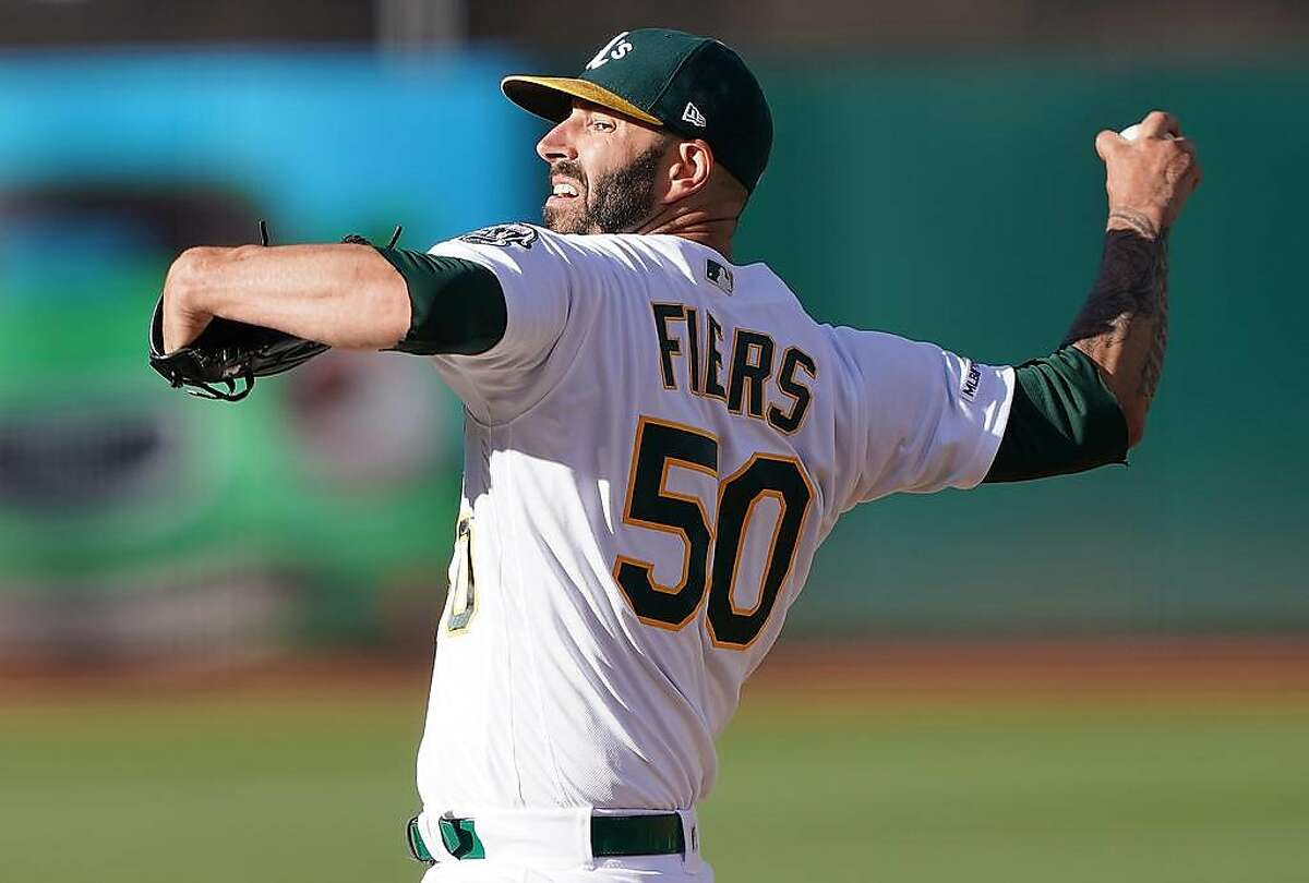 OAKLAND, CA - AUGUST 03: Mike Fiers #50 of the Oakland Athletics pitches against the St. Louis Cardinals in the top of the first inning at Ring Central Coliseum on August 3, 2019 in Oakland, California. (Photo by Thearon W. Henderson/Getty Images)