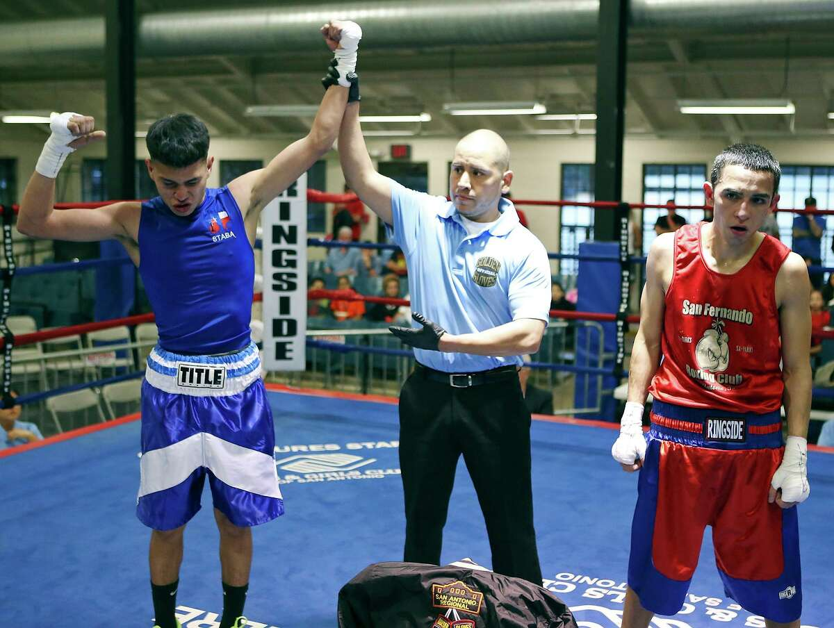 Israel Ibarra (left) celebrates after defeating Joel Maldonado (right) in their novice flyweight championship bout part of the semifinals of the 2015 San Antonio Regional Golden Gloves boxing tournament Friday Feb. 20, 2015 at Woodlawn Gym. Ibarra won by a unanimous decision.