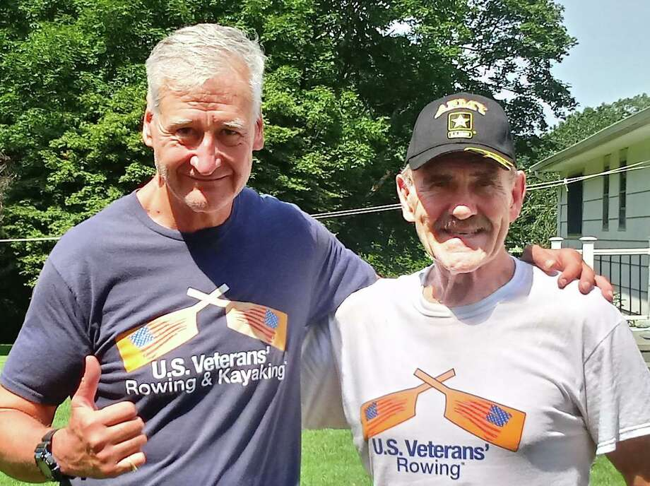 Middletown resident Jerry Augustine, right, of the U.S. Veterans' Rowing & Kayaking Foundation, set a new world indoor rowing record July 20 in his 70-79 age group category. Augustine completed the 6,000 meter distance in 31 minutes and 23 seconds. He's shown here with foundation founder Paul Varszegi. Photo: Contributed Photo