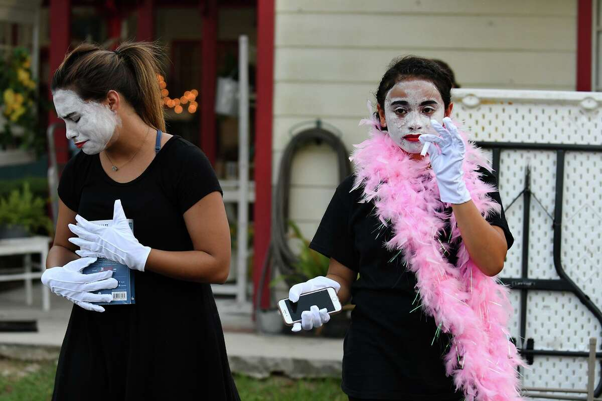 Valery Marcial, from left, and Vicky Sillero, 13, an 8th grader at Magnolia Junior High, both members of the pantomime group