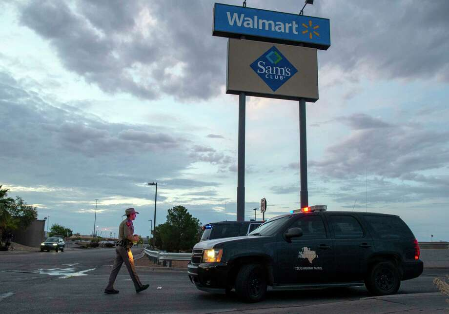 A Texas State Trooper walks back to his car while providing security outside the Walmart store in the aftermath of a mass shooting in El Paso, Texas, Sunday, Aug. 4, 2019. Photo: Andres Leighton, AP / Copyright 2019 The Associated Press. All rights reserved.