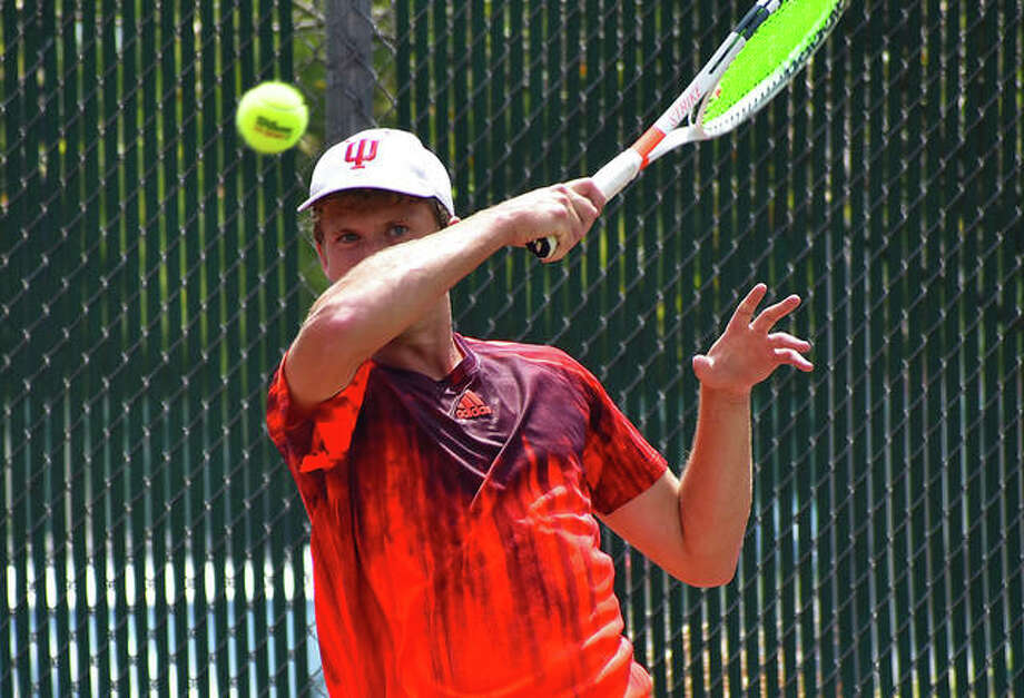 Carson Haskins watches his forehand shot head towards the net in the first set on Saturday in the Pro Wildcard Challenge at the EHS Tennis Center. Photo: Matt Kamp|The Intelligencer