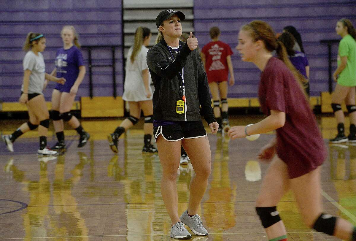 Port Neches - Groves new volleyball head coach Brittany Fruge shouts practice instructions as the Rock-A-Noos get ready for the start of their new season, which starts with a game against Bridge City Tuesday. Photo taken Friday, August 2, 2019 Kim Brent/The Enterprise