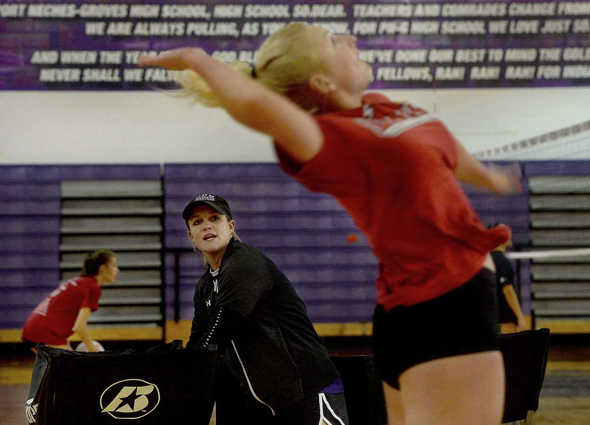 Port Neches - Groves new volleyball head coach Brittany Fruge watches as Kasidee Sartin spikes the ball as the Rock-A-Noos get ready for the start of their new season, which starts with a game against Bridge City Tuesday. Photo taken Friday, August 2, 2019 Kim Brent/The Enterprise