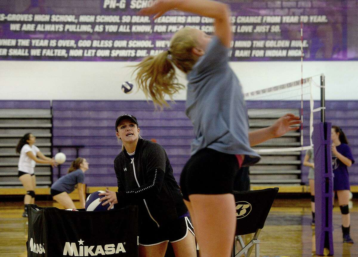 Port Neches - Groves new volleyball head coach Brittany Fruge watches as Kaylee Hooper spikes the ball as the Rock-A-Noos get ready for the start of their new season, which starts with a game against Bridge City Tuesday. Photo taken Friday, August 2, 2019 Kim Brent/The Enterprise
