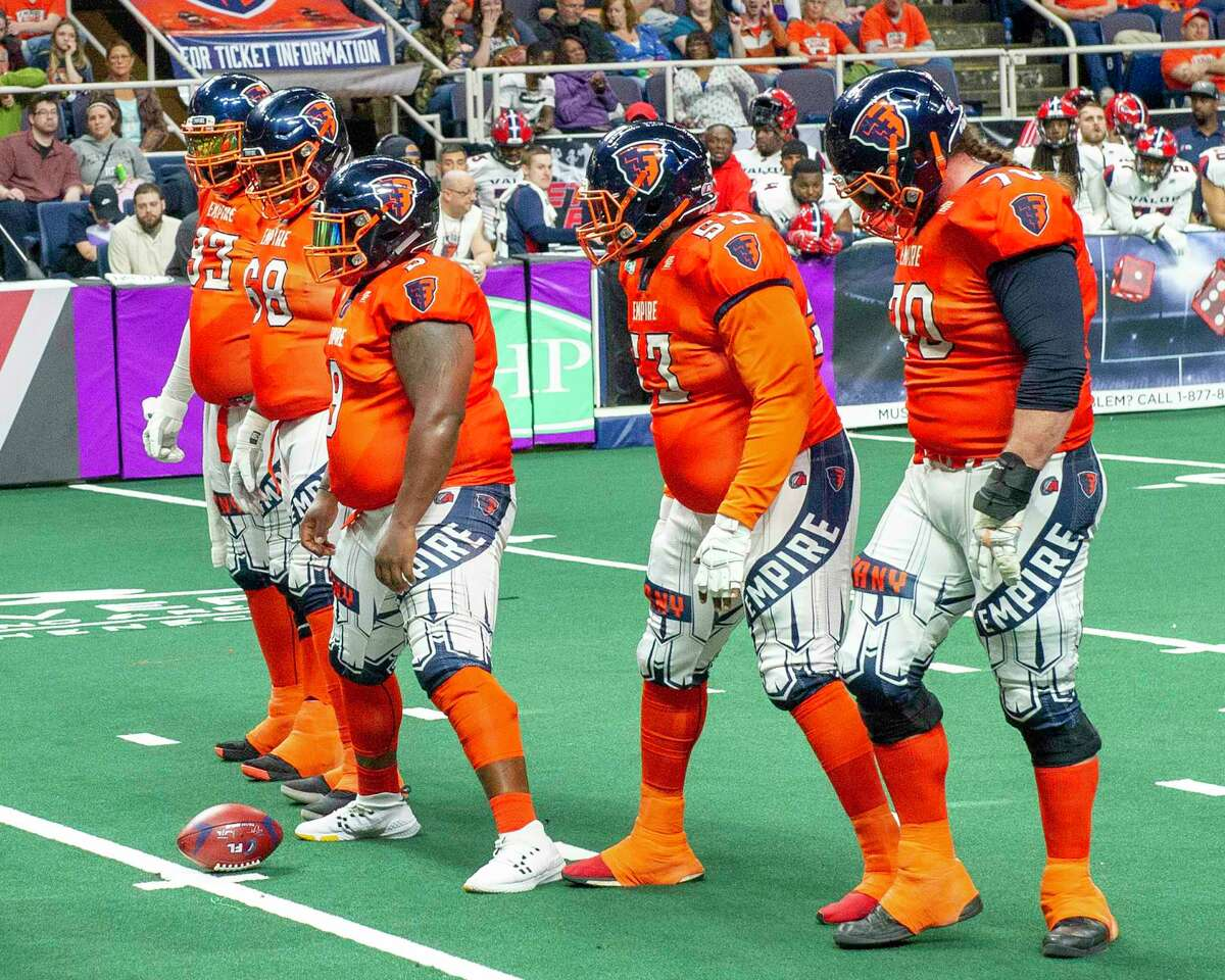 The Albany Empire offensive line from left Moqut Ruffins, Ryan Cave, Jakobie Smith and Jordan Mudge. In the center position is fullback Mykel Benson, who is handling the snap on this play during a game against the Washington Valor at the Times Union Center on Saturday, May 4, 2019 (Jim Franco/Special to the Times Union.)