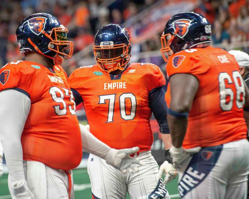 Albany Empire offensive lineman Jordan Mudge (70) talks to fellow lineman Moqut Ruffins (93) and center Ryan Cave (68) during a game against the Washington Valor at the Times Union Center on Saturday, May 4, 2019 (Jim Franco/Special to the Times Union.)