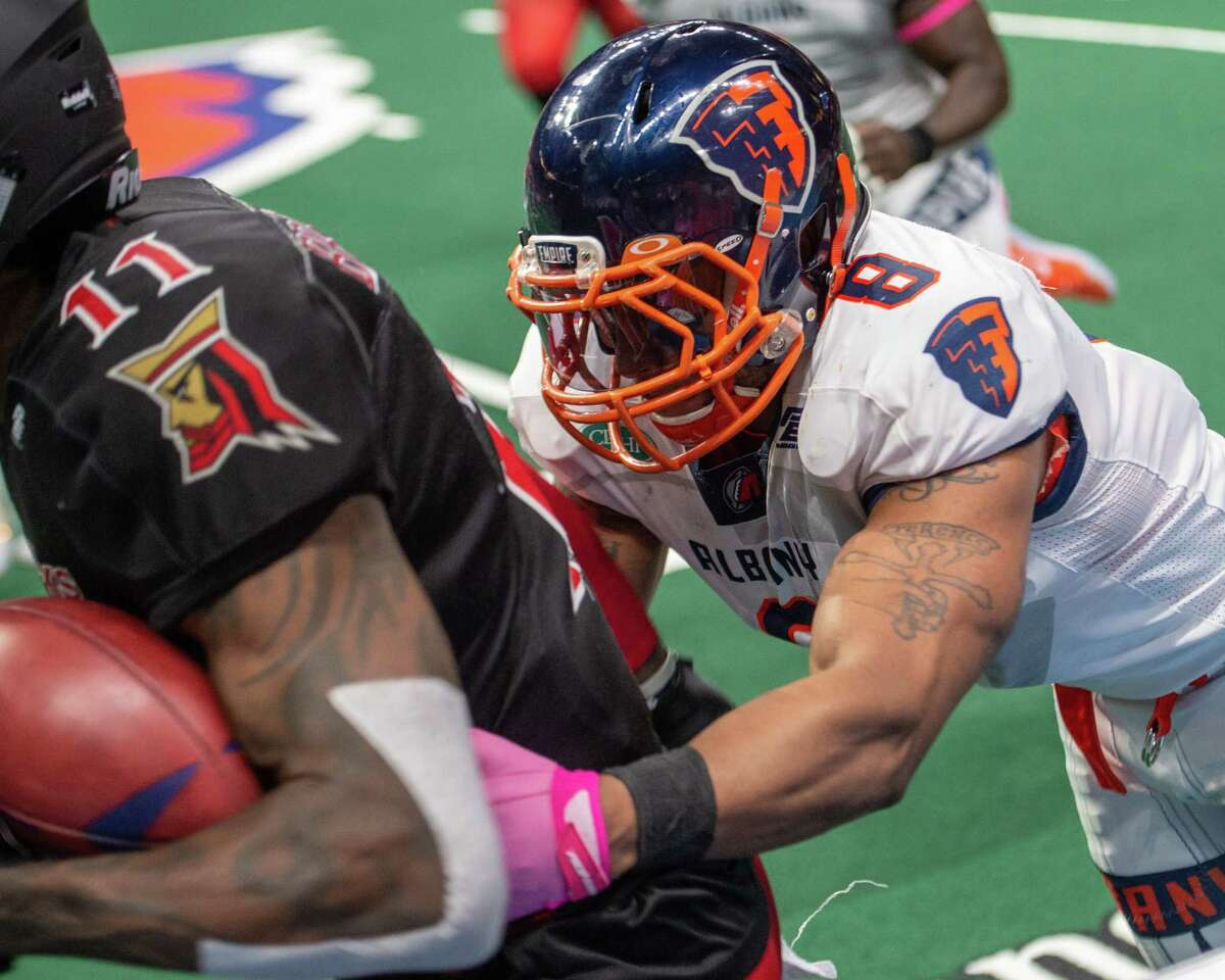 Albany Empire linebacker Terence Moore tackles Atlantic City Blackjack wide receiver Lamark Brown at the Times Union Center on Saturday, June 22, 2019 (Jim Franco/Special to the Times Union.)