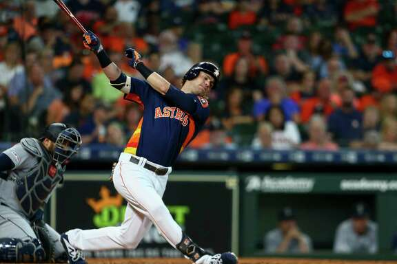Houston Astros right fielder Josh Reddick (22) strikes out  against the Seattle Mariners during the third inning of an MLB game at Minute Maid Park Sunday, Aug. 4, 2019, in Houston.