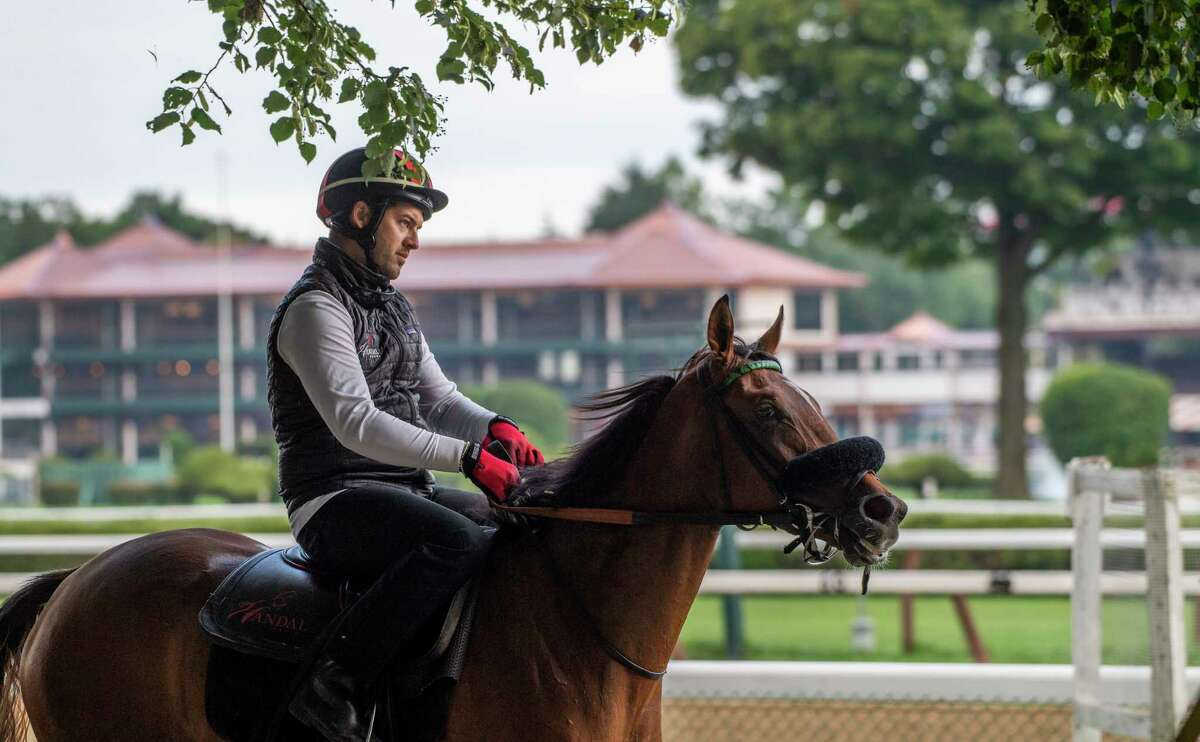 Trainer Ray Handel goes out with one of his charges for exercise with a background of the new 1863 Club at the Saratoga Race Course Sunday, Aug. 4, 2019 in Saratoga Springs, N.Y. Photo Special to the Times Union by Skip Dickstein