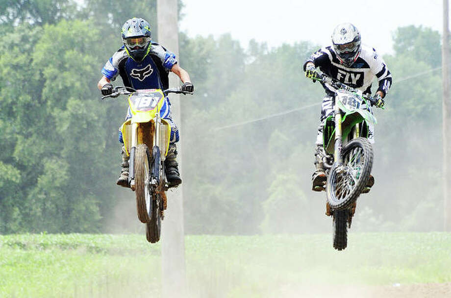 Riders catch some air at the Ride Organic track north of Alton on Saturday. Photo: David Blanchette   The Telegraph
