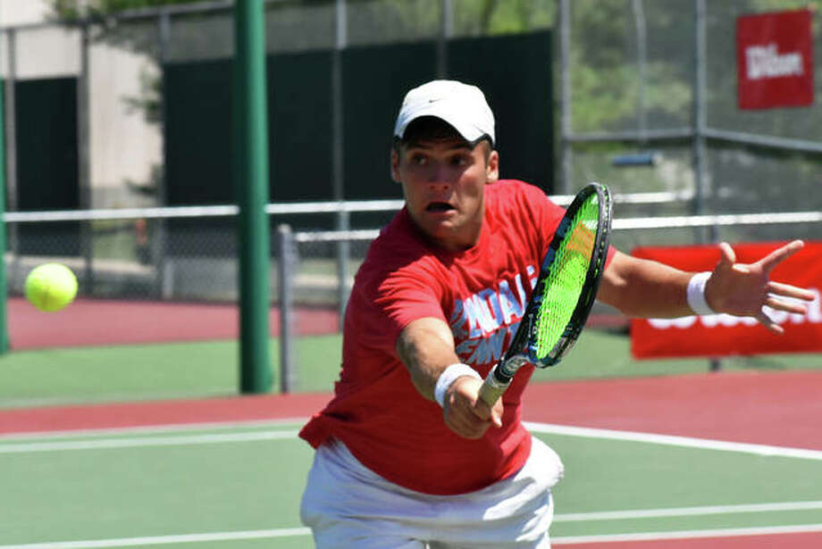 Seth Lipe reaches for a shot during the final of the Doubles Shootout on Sunday. Lipe and Zach Trimpe lost in the championship match of the one-day tournament.