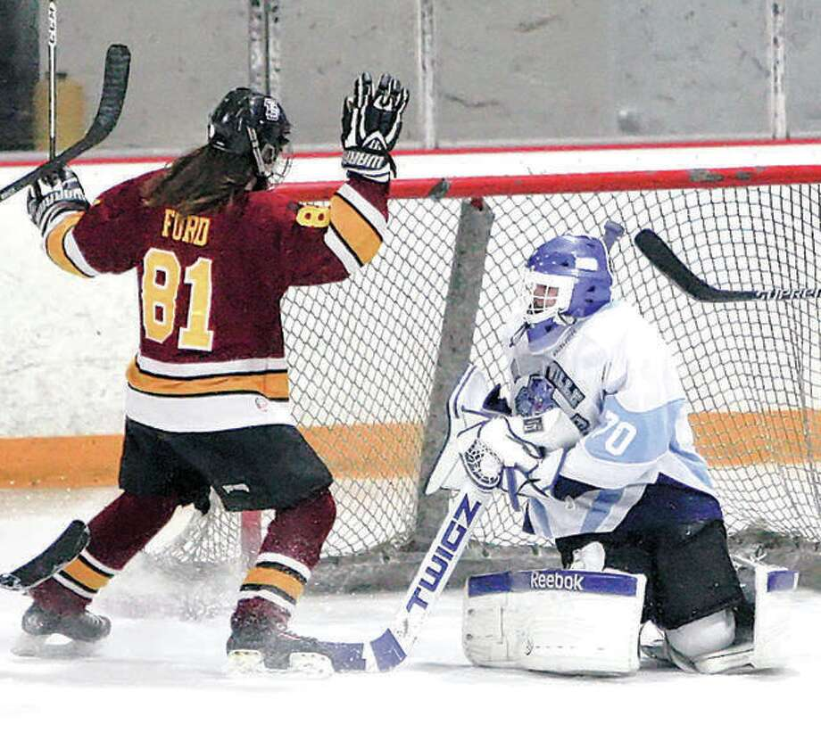 Former EA-WR standout Cole Ford celebrates a goal against Jerseyville during his MVCHA hockey days. The Oilers, charter members of the Mississippi Valley Club Hockey Association, recently got a boost when longtime area coach and St. Louis Hockey Hall of Famer Larry Thatcher came on board as head coach for the upcoming season. Photo: Telergraph Fle Photo