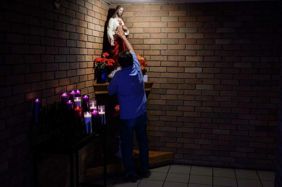 A man touches a statue after Sunday services at the Santo Nino de Atocha church in El Paso, Texas, on Sunday, Aug. 4, 2019. The sermon asked the congregation to think of those who are suffering in the wake of the shooting here and in Dayton, Ohio, that has left at least 29 dead. Photo: Washington Post Photo By Michael Robinson Chavez. / The Washington Post