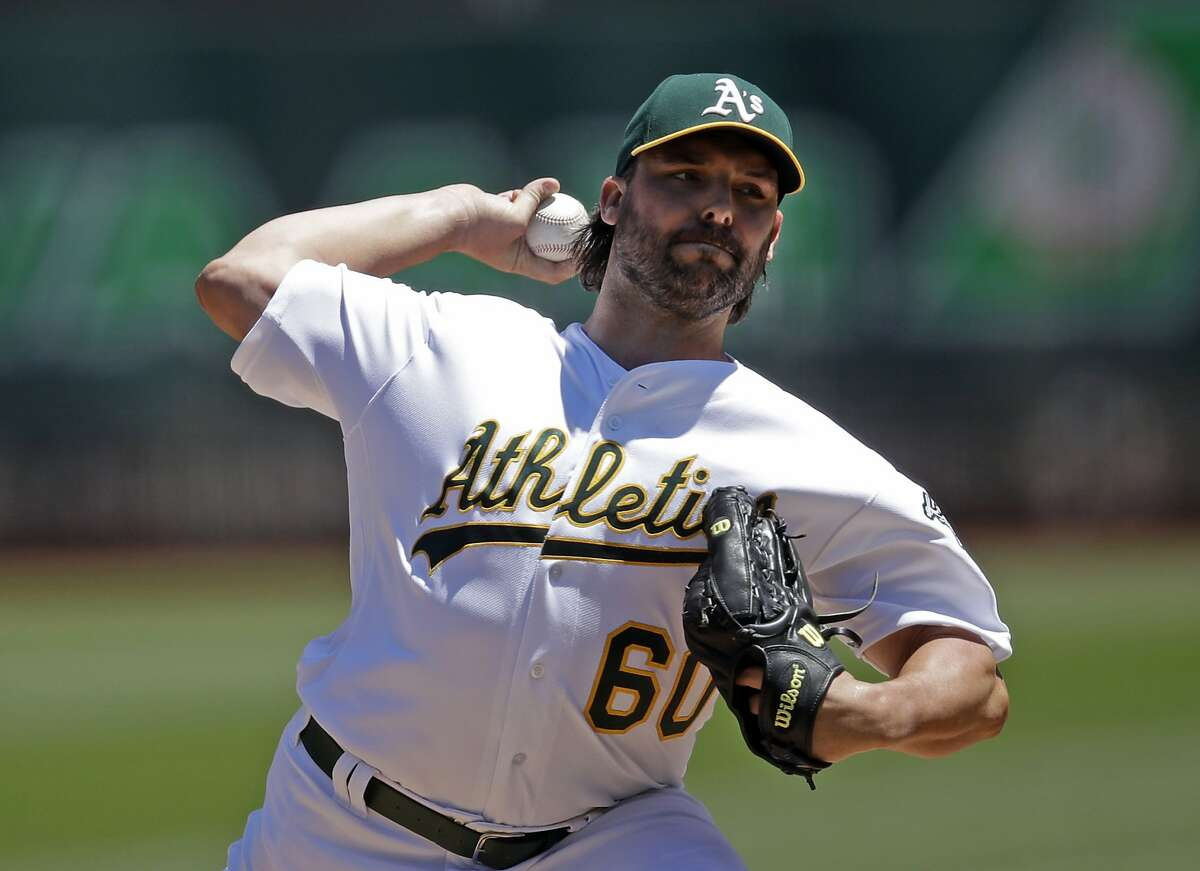 Oakland Athletics' pitcher Tanner Roark works against the St. Louis Cardinals in the first inning of a baseball game Sunday, Aug. 4, 2019, in Oakland, Calif. (AP Photo/Ben Margot)