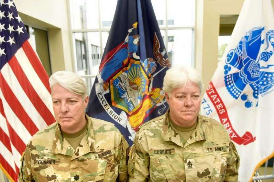 Twins Lt. Col. Lynn Currier, left, and Master Sgt. Lisa Currier await retirement at New York Army National Guard Headquarters in Latham. (New York Army National Guard)