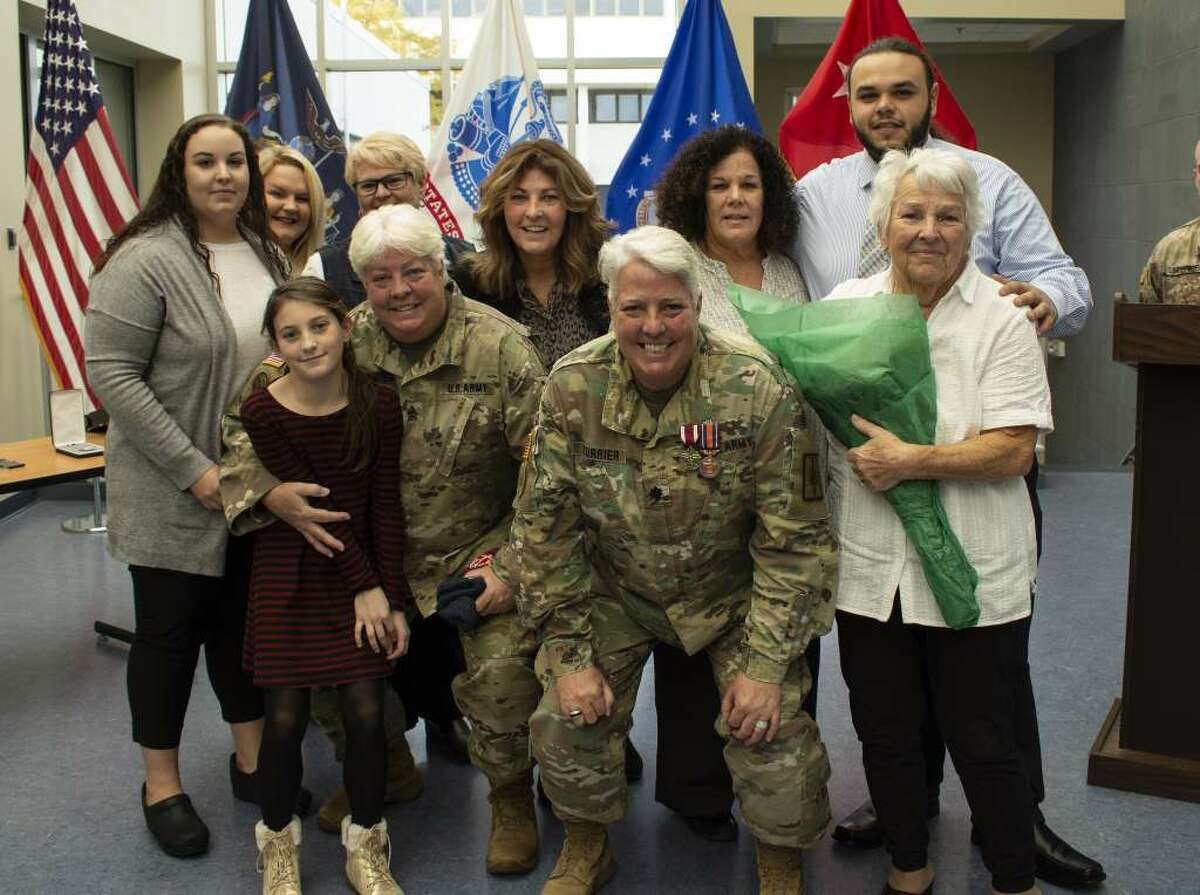Twins New York Army National Guard Master Sgt. Lisa Currier, left, and Lt. Col. Lynn Cuirrier and their family gather at a retirement ceremony at New York Army National Guard Headquarters in Latham. (New York Army National Guard)