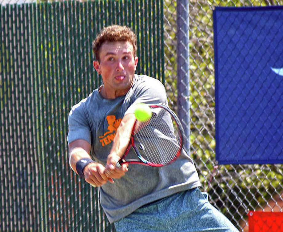 Preston Touliatos returns a serve during the Doubles Shootout on Sunday at the EHS Tennis Center.