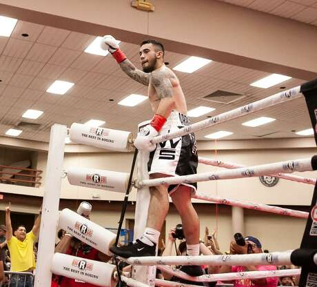 San Antonio boxer Henry Arredondo celebrates on the ropes after his second- round knockout victory over Alejandro Moreno on Saturday at the Shrine Auditorium.