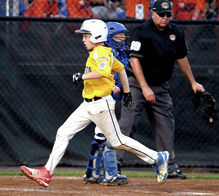 Christian Kells of Madison scores in the third inning on Nicholas Maynard's two-out double against Vermont in the Little League New England regional Sunday in Bristol. Photo: Arnold Gold / Hearst Connecticut Media / New Haven Register