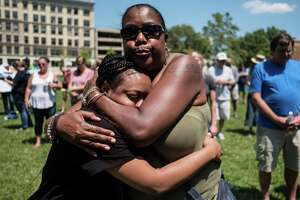 """People are seen in an emotional embrace at a vigil for victims of an active shooter that took place in Dayton, Ohio on August 04, 2019. - Nine people were killed in a mass shooting early Sunday in Dayton, Ohio, police said, adding that the assailant was shot dead by responding officers.The incident occurred shortly after 1:00 am in the popular bar and nightlife Oregon district of the city, Police Lieutenant Colonel Matt Carper said.""""We had one shooter that we are aware of and multiple victims,"""" he told reporters.""""The shooter is deceased, from gunshot wounds from the responding officers,"""" he said, adding no police were injured.""""We have nine victims deceased ... and we have approximately 16 more victims hospitalized right now in unknown conditions.""""The suspect had opened fire on the street firing """"a long gun with multiple rounds."""" (Photo by Megan JELINGER / AFP)MEGAN JELINGER/AFP/Getty Images"""