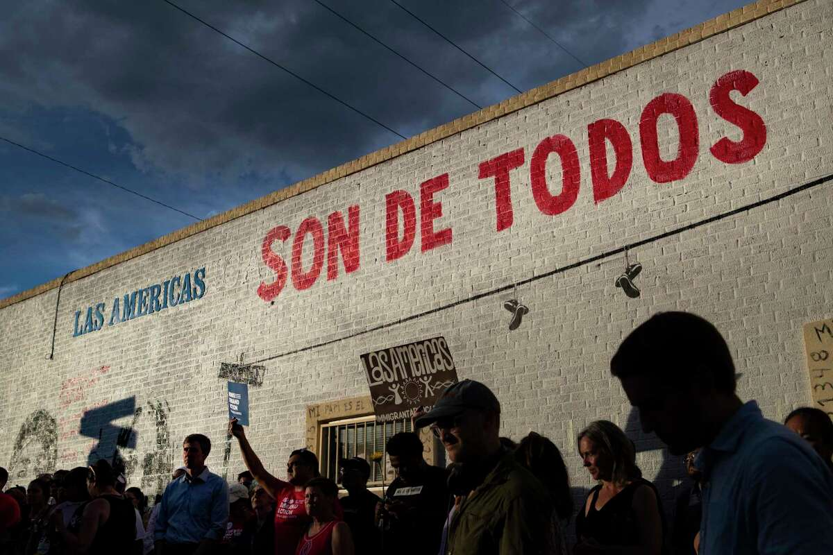 Democratic presidential candidate Beto O'Rourke and a large crowd gather by the new mural at Las Americas Headquarters during an anti violence rally Sunday, Aug. 4, 2019, in El Paso.