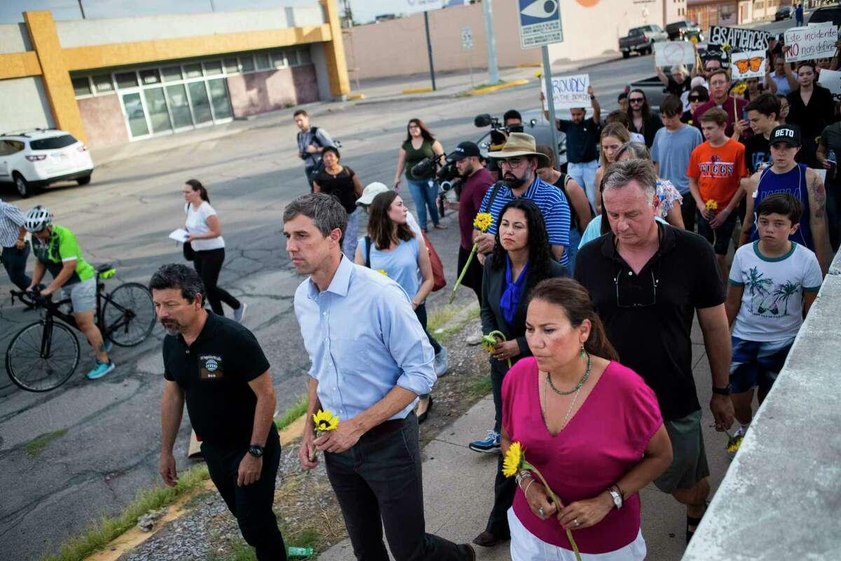 Fernando Garcia, Border Network of Human Rights director, Beto O'Rourke and Rep. Veronica Escobar walk against violence Sunday, Aug. 4, 2019, in El Paso toward Las Americas Headquarters.