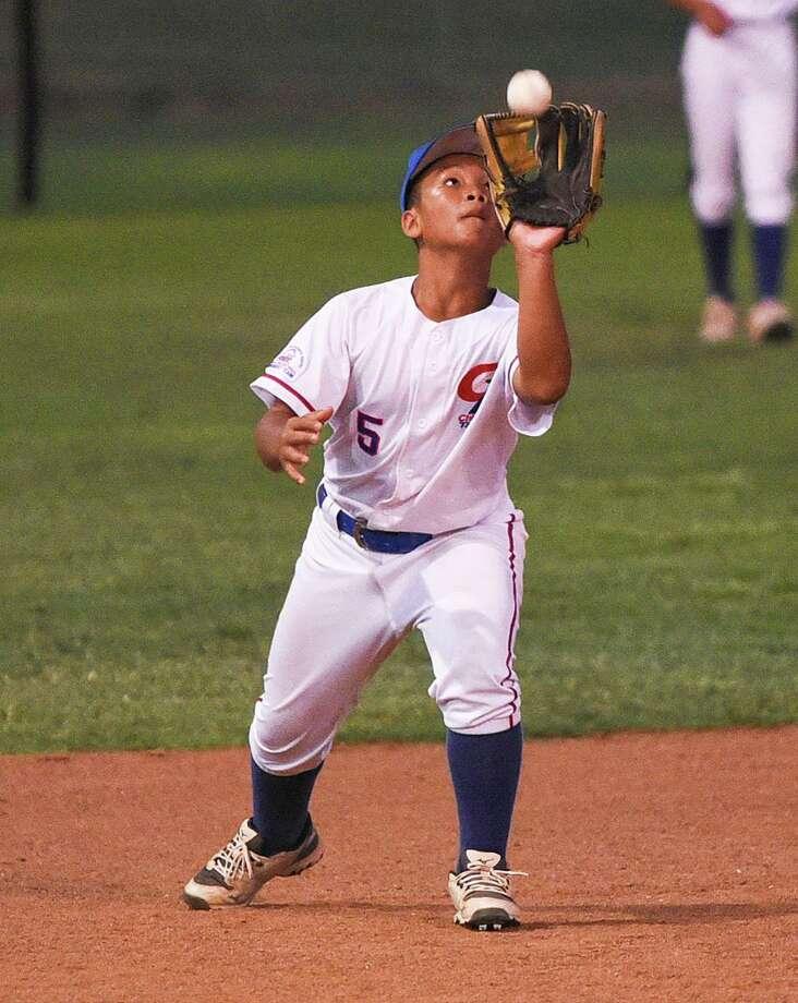 Sheng-En Wang catches a fly ball Saturday at M.E. Benavides Field. Photo: Danny Zaragoza /Laredo Morning Times