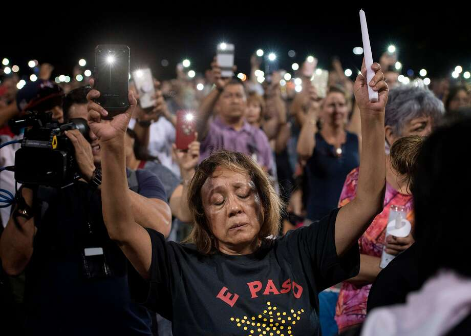 People react during a prayer vigil organized by the city, after a shooting left 20 people dead at the Cielo Vista Mall Wal-Mart in El Paso, Texas, on August 4, 2019. - A shooting at a Walmart store in Texas left multiple people dead. At least one suspect was taken into custody after the shooting in the border city of El Paso, triggering fear and panic among weekend shoppers as well as widespread condemnation. The suspected shooter in the El Paso massacre that left 20 people dead has been charged with murder offenses that can carry the death penalty, police said Sunday. It was the second fatal shooting in less than a week at a Walmart store in the US and comes after a mass shooting in California last weekend. (Photo by Mark RALSTON / AFP)MARK RALSTON/AFP/Getty Images Photo: Mark Ralston, AFP/Getty Images