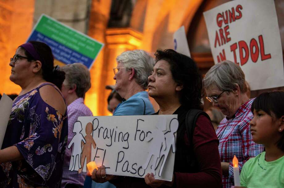 San Antonio area residents and city officials attend a vigil outside San Fernando Cathedral on Aug. 4, 2019, to honor of victims of mass shootings in El Paso and Dayton, Ohio. Photo: Carlos Javier Sanchez /Contributor / Carlos Javier Sanchez