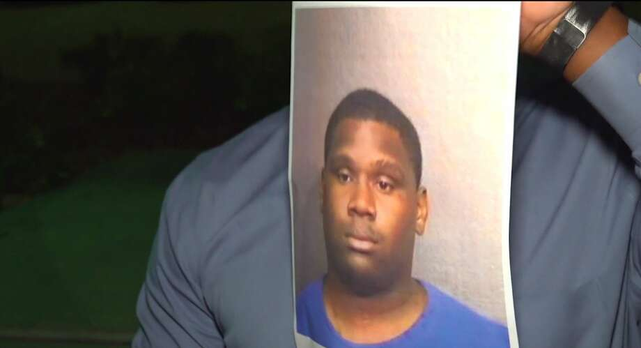 FILE - Officials hold up a photo of Justin Herron, then a person of interest in the August shooting death of his girlfriend, Patra Perkins in Houston, Texas.  Photo: OnScene.TV