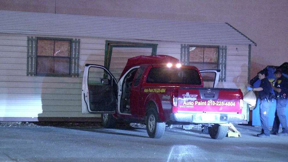 A man is in police custody after they said he allegedly stole a truck, crashed a building and led law enforcement officers on a police chase Sunday night. Photo: Ken Branca
