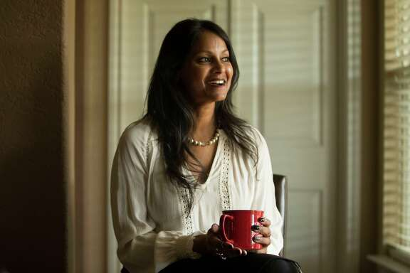 "Founder and executive of San Antonio Amputee Foundation, Mona Patel, 46, takes a break from her work as a part-time social worker. ""We're small,"" she says of the foundation, ""but the things we do are very impactful for individuals. With any mindset you can climb any of the mountains in your life."""