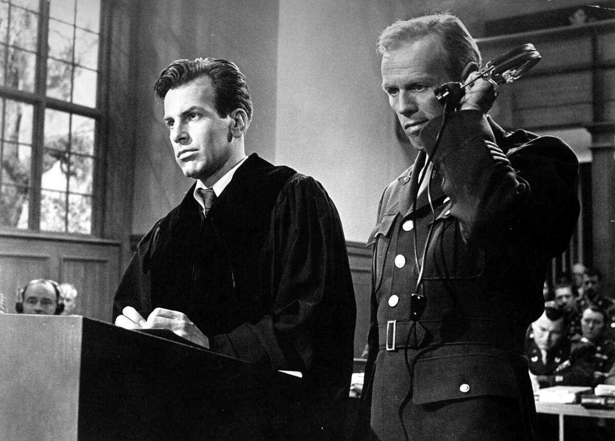 """In this 1962 image originally released by United Artists, Richard Widmark portrays Col. Tad Lawson, right, in a scene with Maximilian Schell in """"Judgment at Nuremberg."""""""
