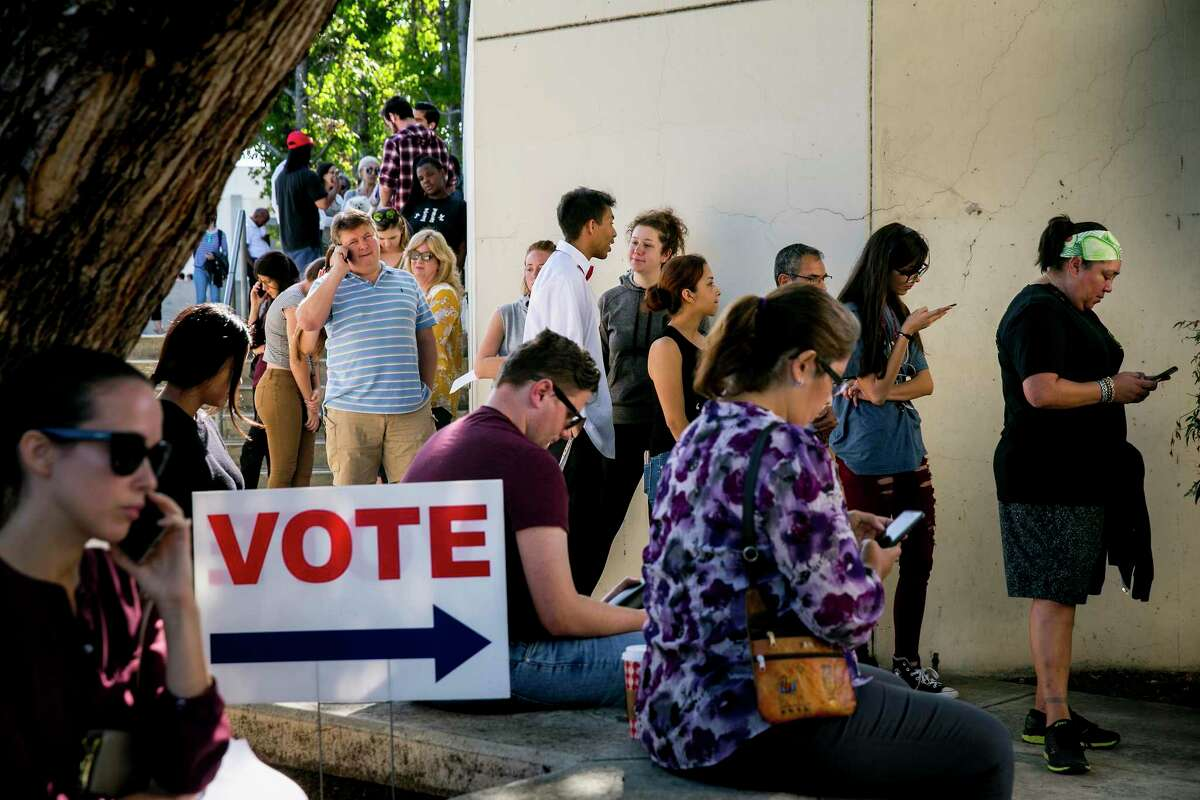 Californians line up to register and vote on Election Day at the Orange County Registrar in Santa Ana, Nov. 6, 2018. Voters turned out on Tuesday at rates not seen in a midterm election in half a century, driven by strong opinions of the president and a string of competitive races in states where robust contests have been rare. (Sam Hodgson/The New York Times)