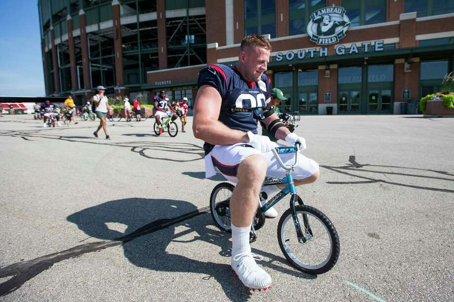 PHOTOS: More of Texans players riding kids' bicycles in Green Bay on Monday