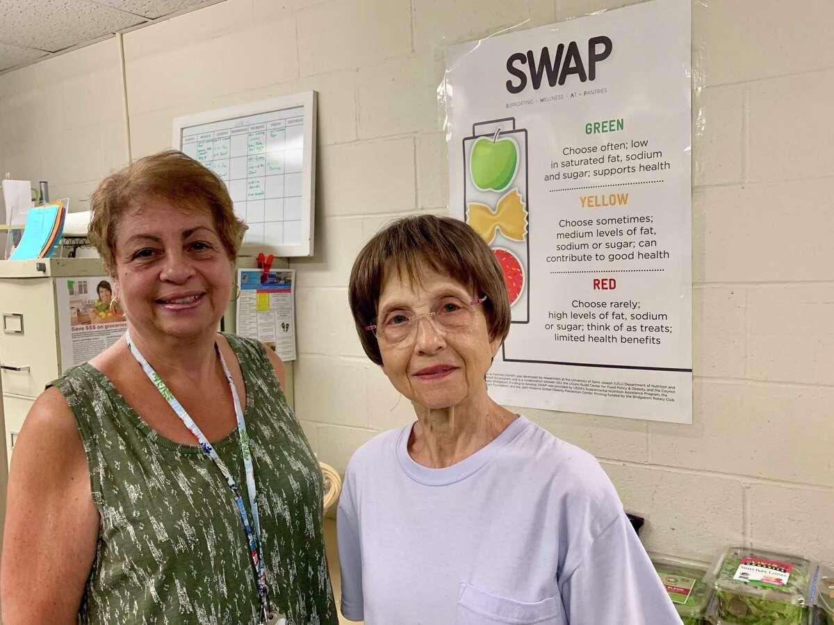 Karen Seferi, food pantry coordinator and Connie Scalise, food pantry volunteer.