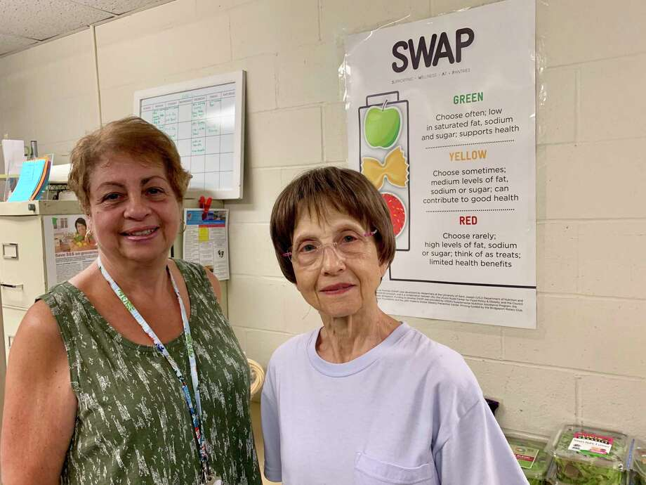 Karen Seferi, food pantry coordinator and Connie Scalise, food pantry volunteer. Photo: Contributed Phot