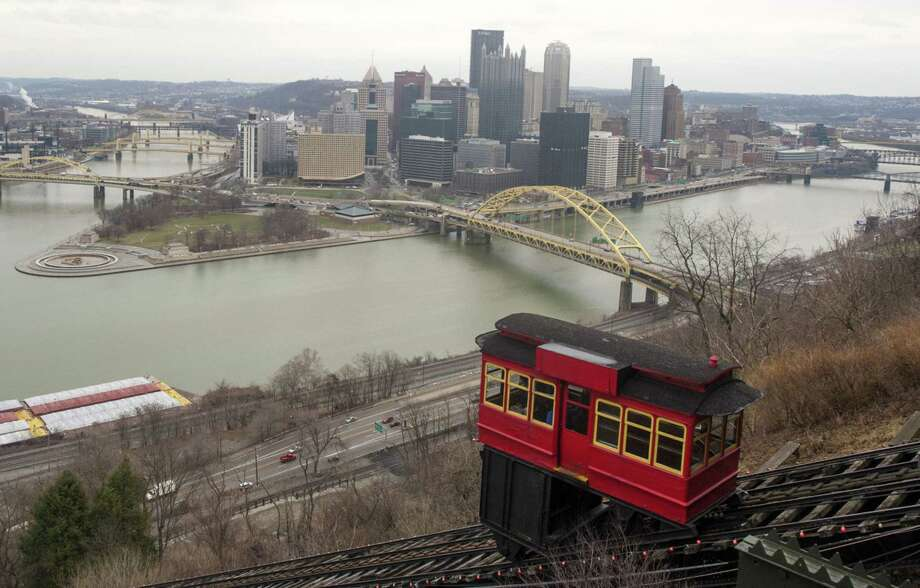 A rail car brings visitors up the Desquene Incline to see views of the city in Pittsburgh on April 4, 2015. Photo: Bloomberg Photo By Ty Wright. / The Washington Post