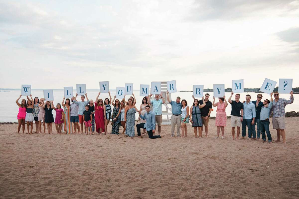 Darien High School graduate Jay Alter proposed to his high school sweetheart Lizzy Van Ingen last weekend at Weed Beach in Darien.