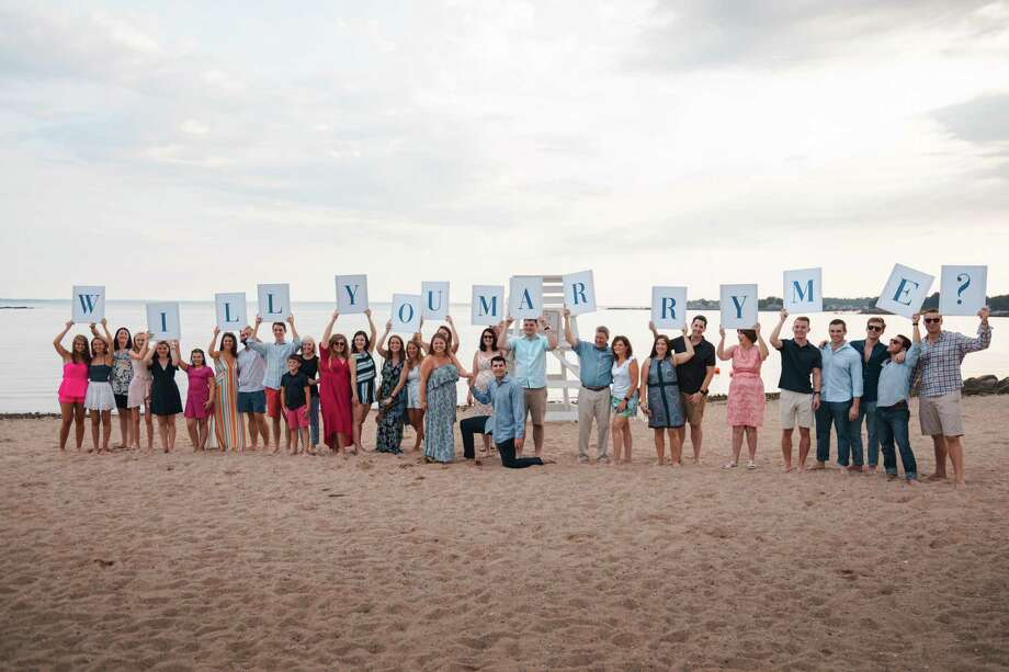 Darien High School graduate Jay Alter proposed to his high school sweetheart Lizzy Van Ingen last weekend at Weed Beach in Darien. Photo: Eric Kanigan / Connecticut Post