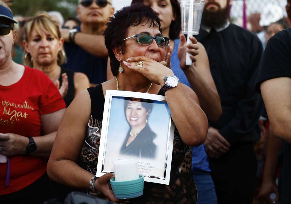 Lupe Lopez carries a photo of Elsa Mendoza Marquez, a Mexican schoolteacher from across the border in Ciudad Juarez who was killed in the shooting, during an interfaith vigil for victims of a mass shooting, which left at least 20 people dead, on August 4, 2019 in El Paso, Texas.