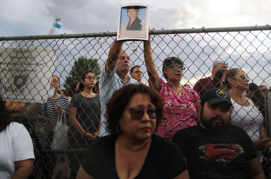 A photo (top) of Elsa Mendoza Marquez, a Mexican schoolteacher from Ciudad Juarez who was killed in the shooting, is held up during an interfaith vigil for victims of a mass shooting, which left at least 20 people dead, on August 4, 2019 in El Paso, Texas. Photo: Mario Tama/Getty Images / 2019 Getty Images