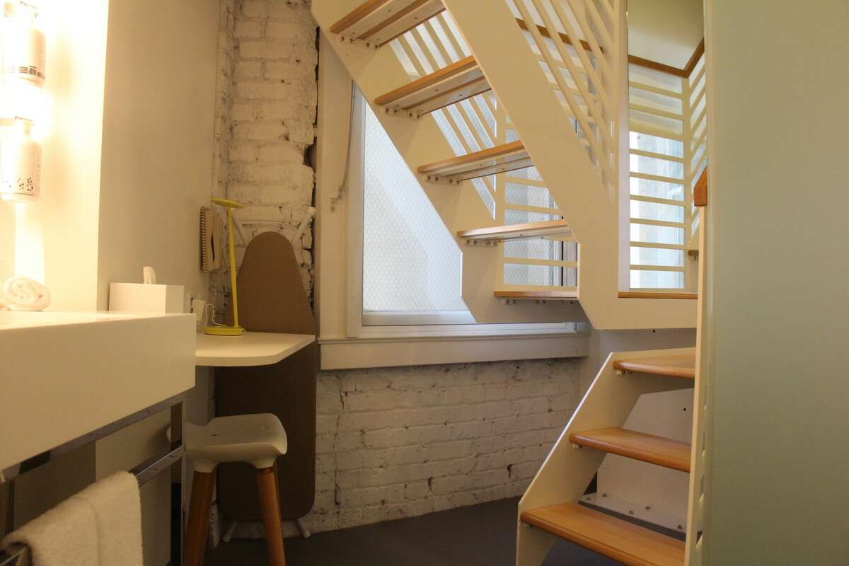 Here's the view when you first walk into the cabin. A U-shaped staircase, standing shower, writing desk, sink and more are found on the lower level. YOTELis San Francisco's latest micro-hotel on Market St. that offers 10 different cabins that range in all sizes. I stayed in the