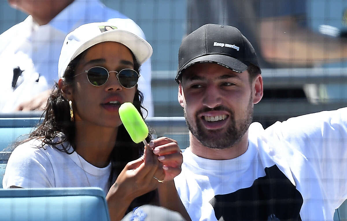 FILE - Klay Thompson of the Golden State Warriors and actress Laura Harrier attend the Los Angeles Dodgers and Miami Marlins game at Dodger Stadium in this July 21, 2019 file photo. Thompson was spotted having what looked like a great time at the Chicago Cubs game against the Milwaukee Brewers on Sunday, Sept. 1.