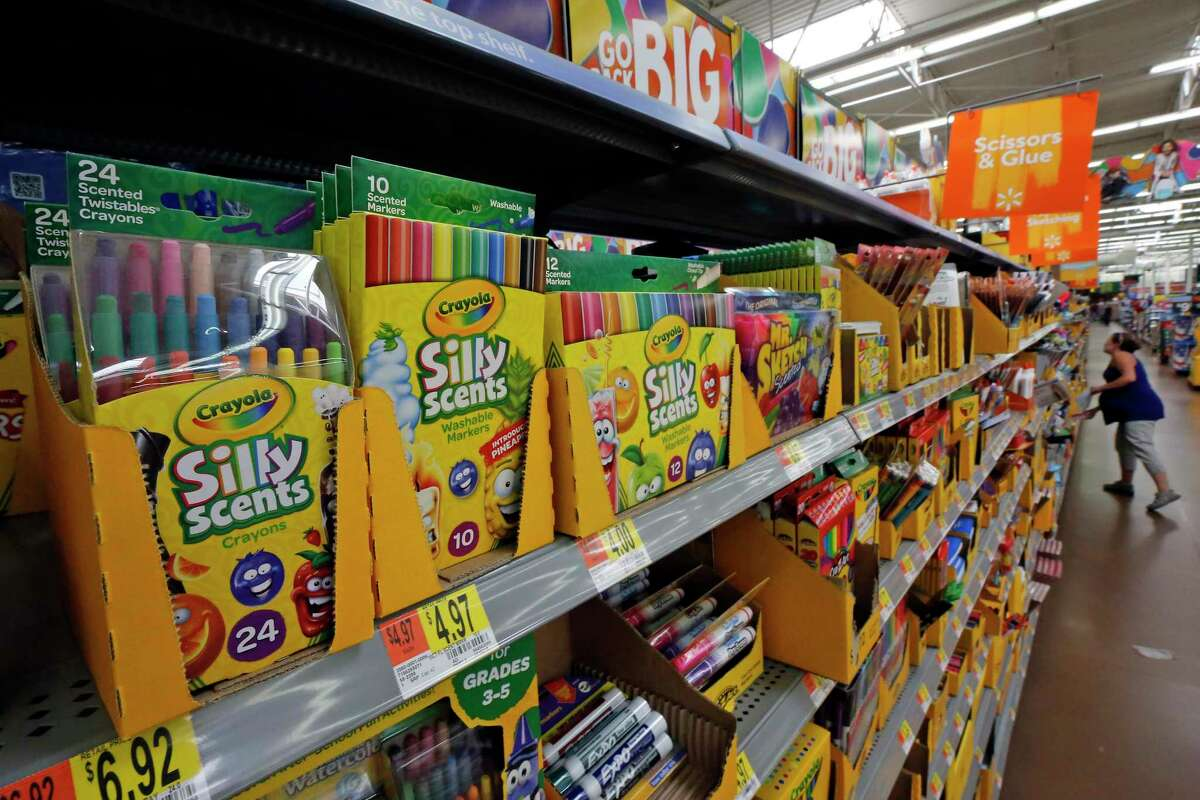 FILE- This July 19, 2018, file photo shows a display of scented markers and crayons in a Walmart in Pittsburgh. Environmentally friendly school supplies often carry big prices, but if you expand your idea of what counts as