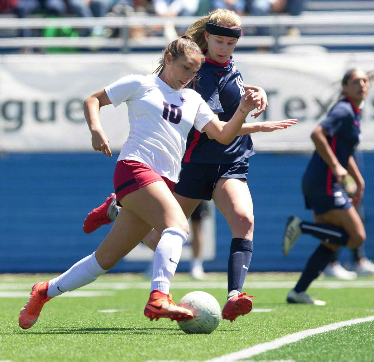 Katy Tompkins forward Barbara Olivieri (10) dribbles the ball under pressure from Allen defender Cassandra Taylor (18) in the first period of a Class 6A girls state semifinal match during the UIL State Soccer Championships at Birkelbach Field, Friday, April 19, 2019, in Georgetown.