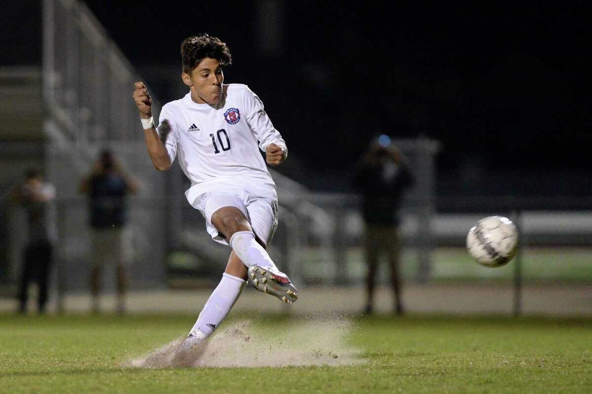 Jovan Prado (10) of Tompkins scores Tompkins' third goal during a shootout to decide the 6A-III regional quarterfinal soccer playoff between the Tompkins Falcons and the Cy Ranch Mustangs on Friday, April 6, 2018 at Tomball Memorial HS, Tomball, TX.