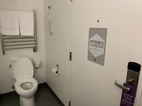 "The toilet stands free in the room and is found directly to the right of the main entrance. YOTEL is San Francisco's latest micro-hotel on Market Street that offers 10 different cabins that range in all sizes. I stayed in the ""Interior Sky"" cabin with a total of 86 square feet (8 square meters). Photo: Susana Guerrero/ SFGATE"