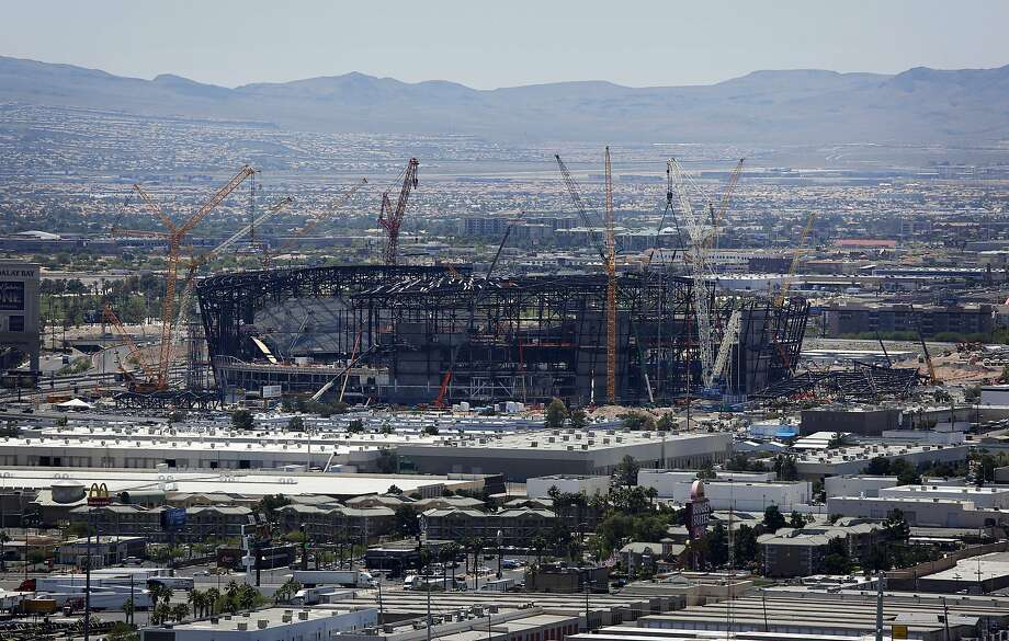 Construction cranes surround the new Las Vegas home of the Raiders in this photo from June. Photo: John Locher / Associated Press